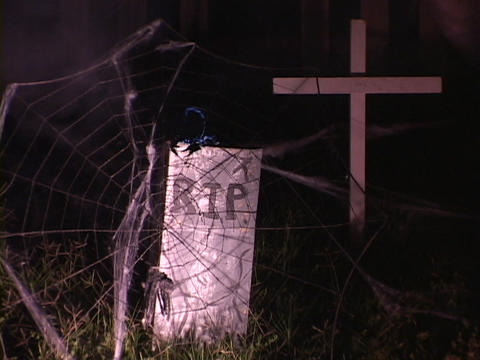 A backyard transforms into a spooky graveyard for Halloween Footage