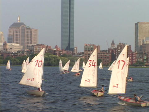 Sailboats sail on the Charles River in Boston Stock Video Footage