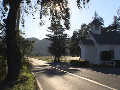 A church sits on a country road Stock Video Footage
