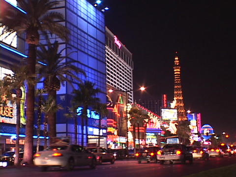 Traffic drives past the hotels and casinos on the Las... Stock Video Footage
