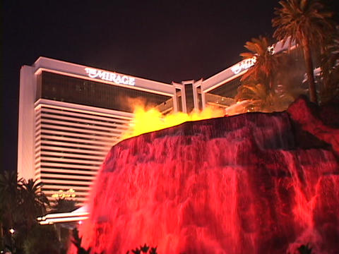 A volcanic fountain erupts in front of the Mirage Hotel... Stock Video Footage