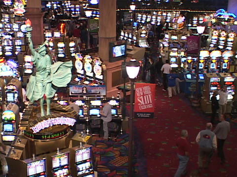 A busy Las Vegas casino swarms with gaming patrons Footage
