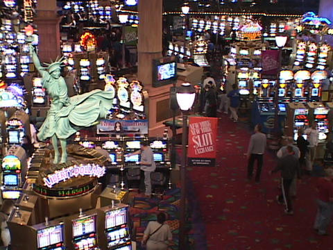 A busy Las Vegas casino swarms with gaming patrons Stock Video Footage