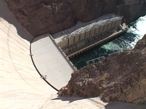 Water churns far below the Hoover Dam Footage