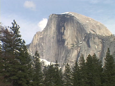 The Half Dome rises above Yosemite National Park Stock Video Footage