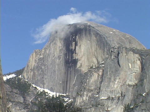 Clouds cap the Half Dome in Yosemite National Park Stock Video Footage