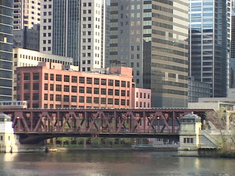 A commuter train crosses a bridge in downtown Chicago,... Stock Video Footage