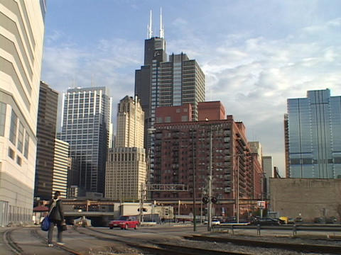 Railroad tracks run in front of the Chicago skyline Stock Video Footage