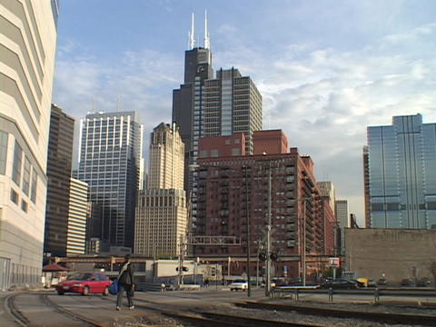 Railroad tracks run in front of the Chicago skyline Footage