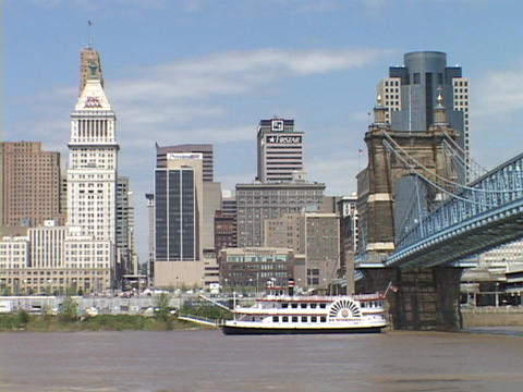 A riverboat passes under a bridge on the Ohio River Footage