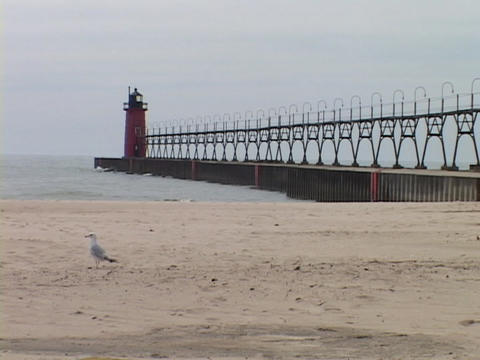A lighthouse stands at the end of a pier in Grand Haven,... Stock Video Footage