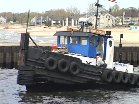A tugboat pulls a barge an Lake Michigan Stock Video Footage