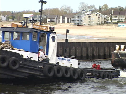 A tugboat pulls a barge an Lake Michigan Footage