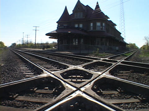 An old Victorian railway station stands amid tracks in Flint, Michigan Footage
