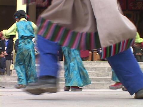Tibetan children dance for the Dalai Lamas Stock Video Footage