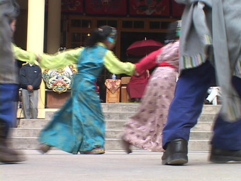 Tibetan children dance for the Dalai Lamas Stock Video Footage