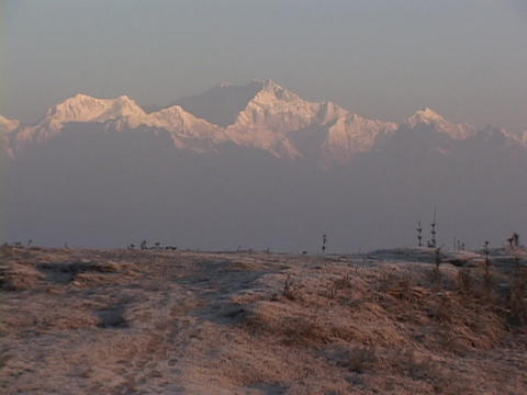 Snow covers the distant Himalayan mountain range Stock Video Footage