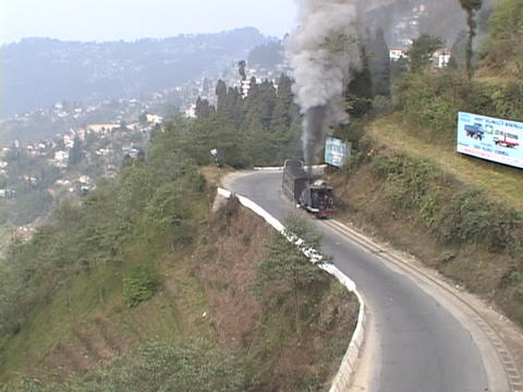 Steam train winds through the mountains near Darjeeling,... Stock Video Footage