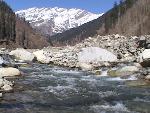 A stream with pure mountain ice water flows in the... Stock Video Footage
