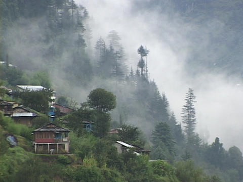 Mist rises from a mountainside in the Himalayas Stock Video Footage