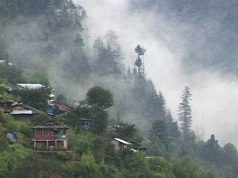 Mist rises from a mountainside in the Himalayas Footage
