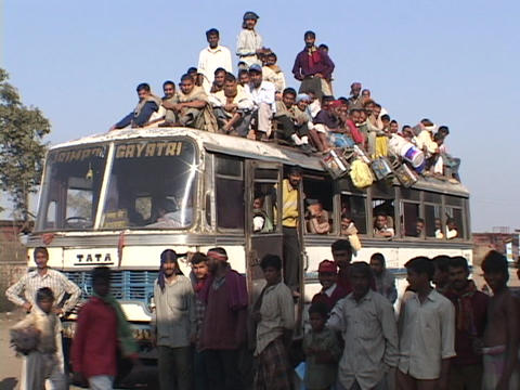 Passengers sit atop a crowded bus Stock Video Footage