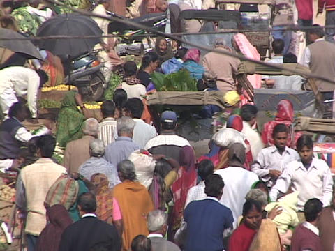Pedestrians walk on a crowded city street in India Stock Video Footage
