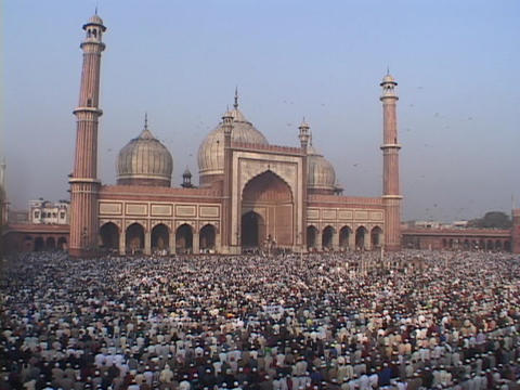 Thousands of Muslims pray at the Jama Masjid Mosque in New Delhi, India Footage