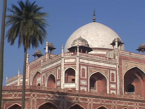 Homayun's Tomb in Delhi, India, features a white dome and many arches Footage
