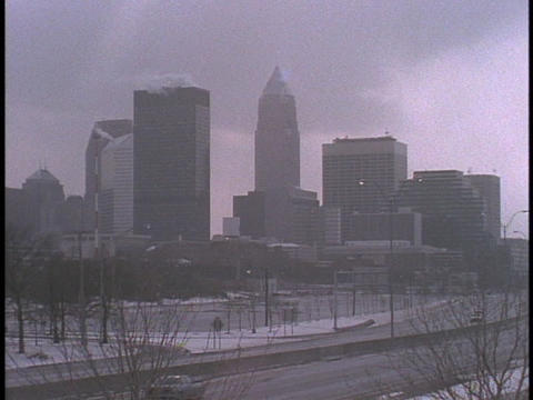 Cleveland's skyline towers over a highway Stock Video Footage