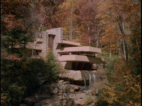 Autumn woods frame Frank Lloyd Wrights Falling Water house Stock Video Footage