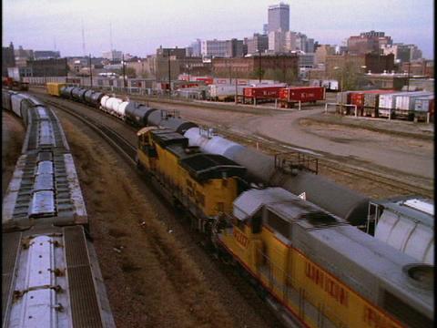 A freight train travels past the Omaha, Nebraska skyline Footage