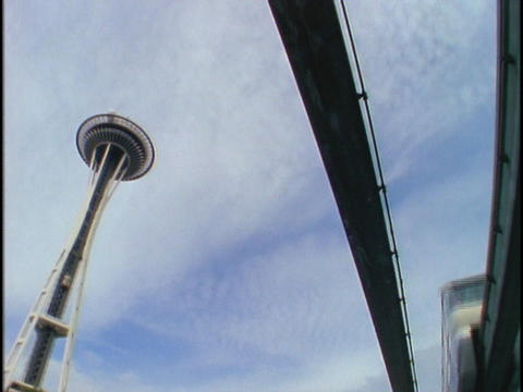 A monorail drives past the Seattle Space Needle Stock Video Footage
