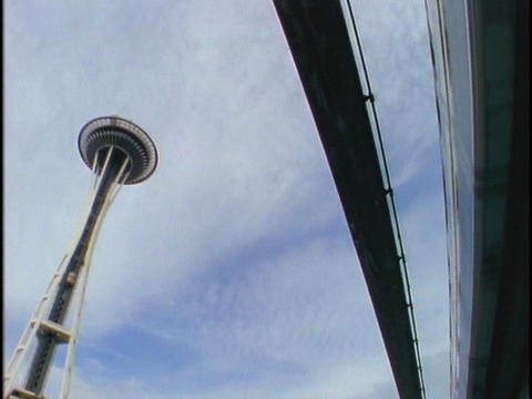A monorail drives past the Seattle Space Needle Footage