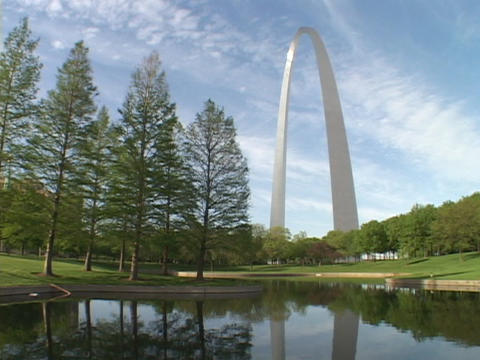 The St. Louis arch reflects in a pond Footage