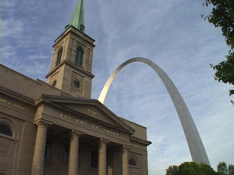 The St. Louis arch rises above an old church Stock Video Footage