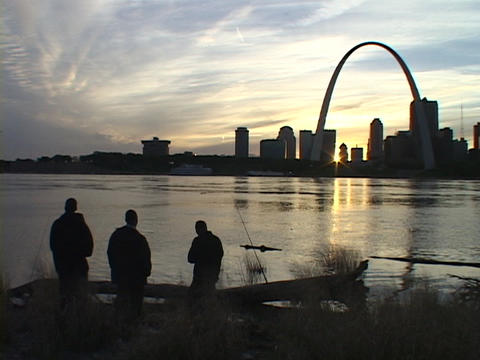 Fishermen gaze across the Mississippi river at the St. Louis arch Footage