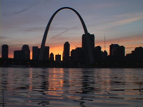 The silhouetted St. Louis towers over the Mississippi River Footage