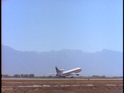 A passenger plane takes off from an airport Footage