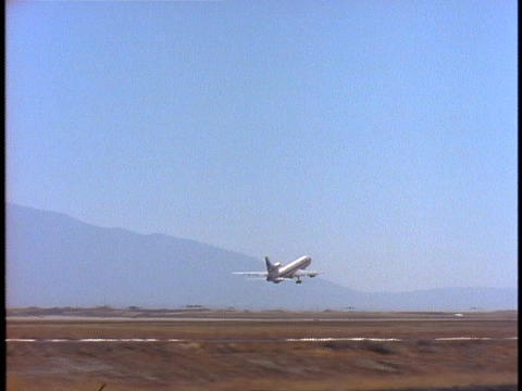 A passenger plane takes off from an airport Stock Video Footage
