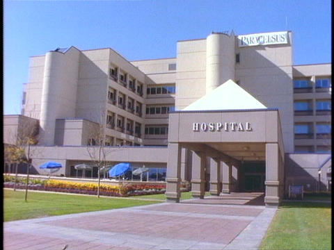 A brick walkway leads into a hospital Stock Video Footage