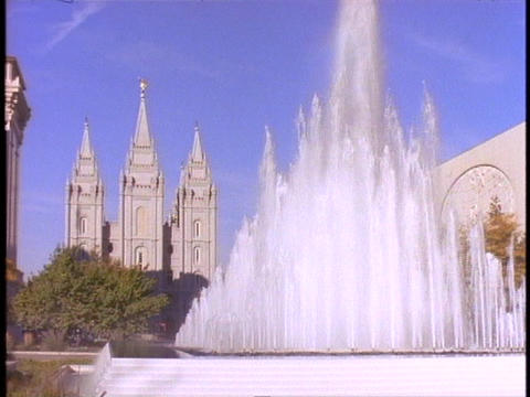 A fountain sprays near the Mormon Temple in Salt Lake City, Utah Footage