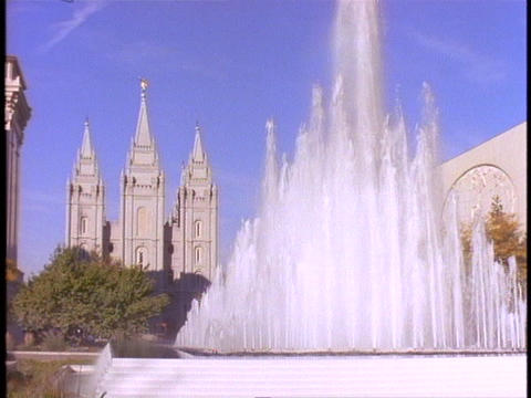 A fountain sprays near the Mormon Temple in Salt Lake... Stock Video Footage