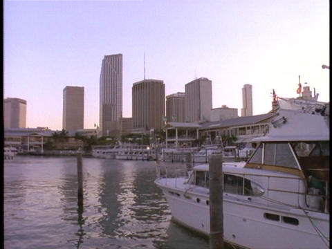 A boat sits in dock near downtown Miami, Florida Stock Video Footage