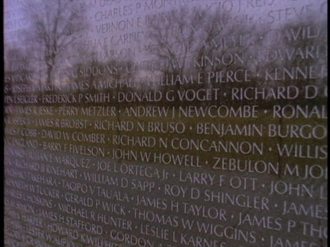 The Vietnam War Memorial reflects the image of a man Stock Video Footage