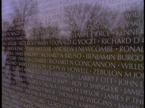 The Vietnam War Memorial reflects the image of a man Footage