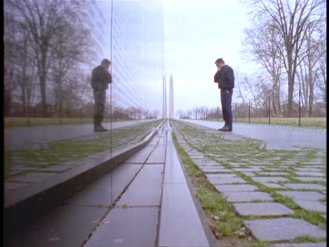 A man prays in front of the Vietnam Wall Stock Video Footage