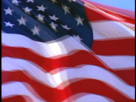 An American flag flies in the wind Footage