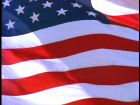 An American flag flies in the wind Stock Video Footage