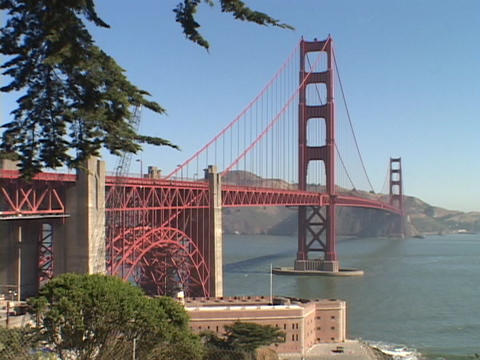 The Golden Gate Bridge spans across the San Francisco harbor Footage